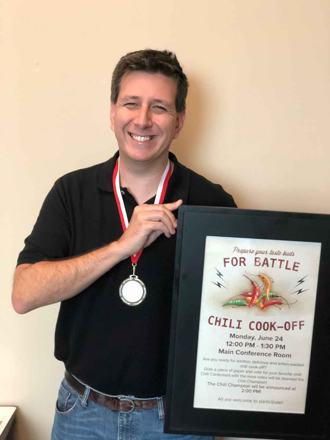 Image of an R and K employee wearing a Chili Cook Off medal