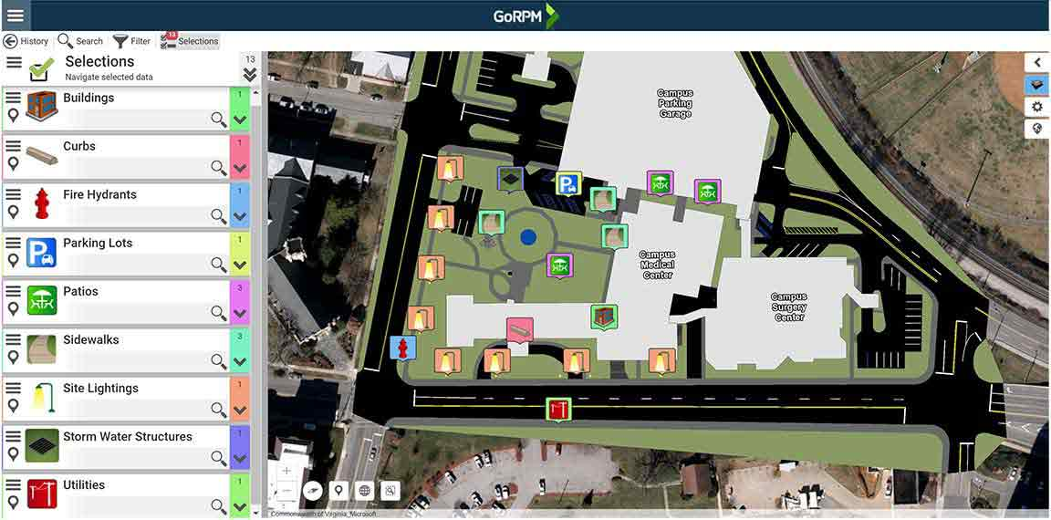 GoRPM screenshot of a building in a facility with indicator badges showing where site lighting, sidewalks, and fire hydrant are located
